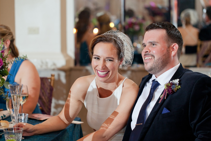bride laughing during mother of bride speech