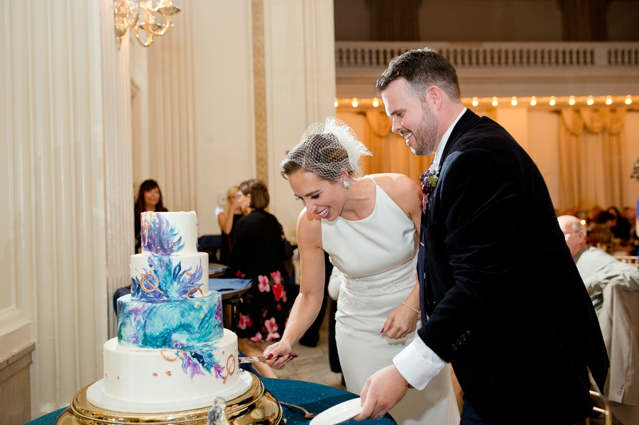 couple at the westin great southern cutting wedding cake