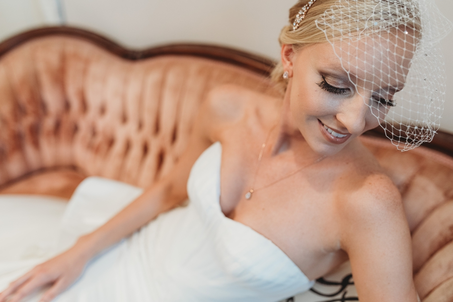 bride on velvet couch