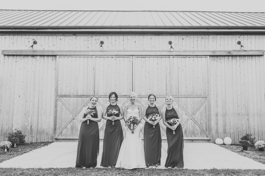 black and white photo of bride and bridesmaids laughing