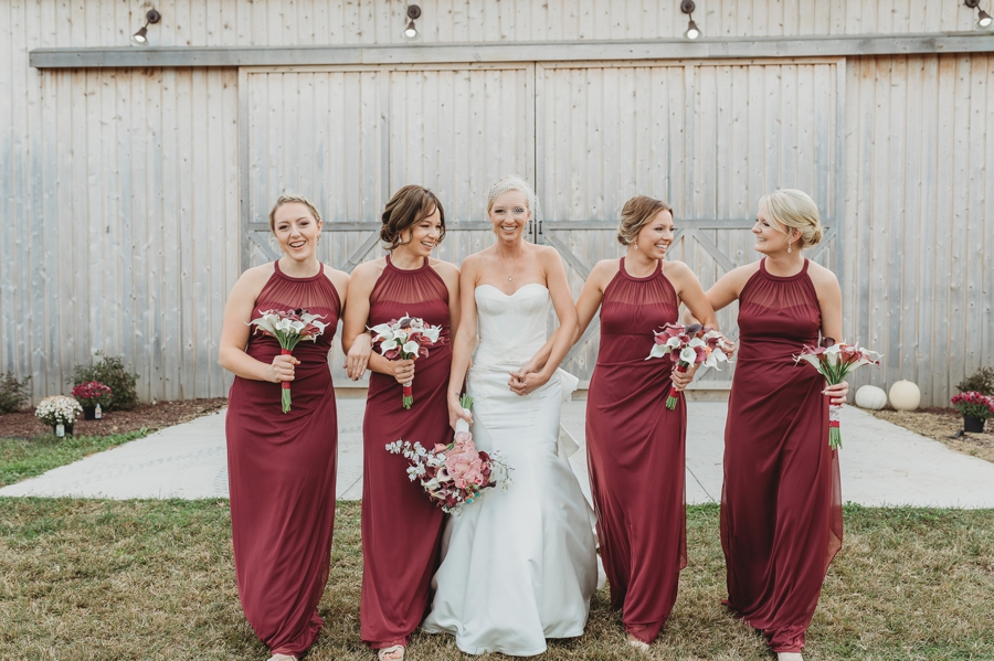 bride and bridesmaids walking at a winery wedding