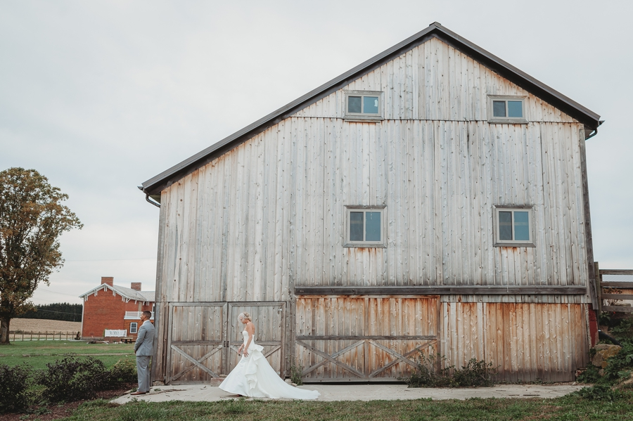 wide photo of first look at a winery wedding in columbus ohio