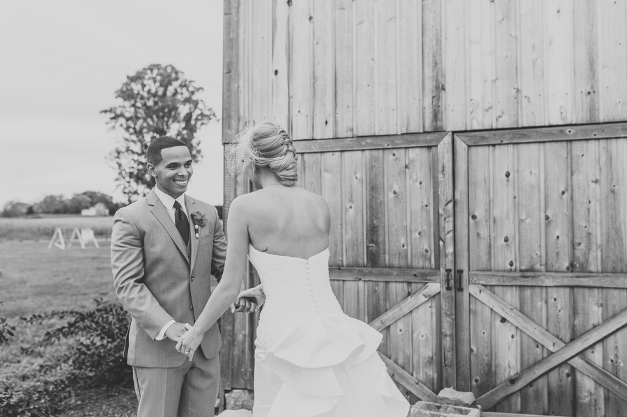 black and white photo of grooms reaction to seeing bride