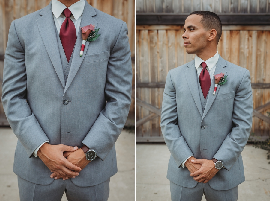 close up photo of grooms gray and burgundy suit