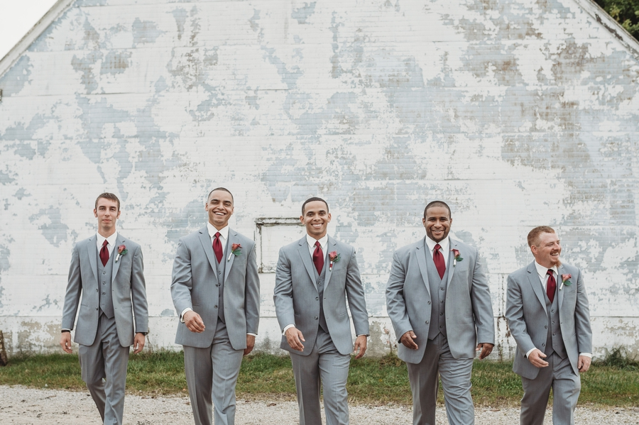 groom and groomsmen walking at a winery wedding