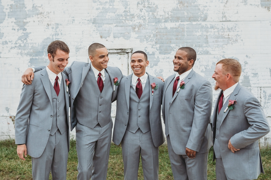 group hug photo of groomsmen and groom