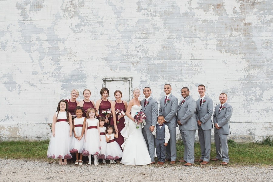 wide photo of wedding party with flowergirls and ring bearer