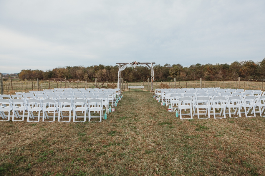 wide photo of outdoor ceremony at a winery wedding