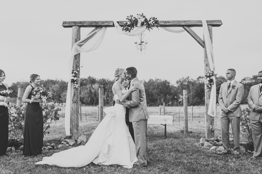 first kiss as husband and wife at at a winery wedding