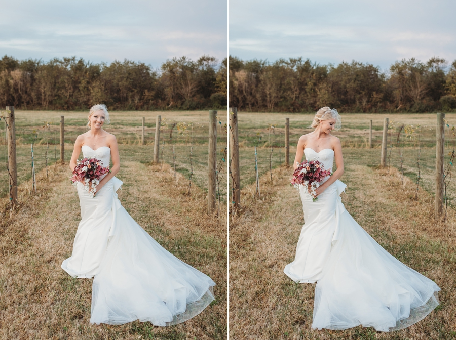 bride smiling in vineyard at at vinberige vineyard winery wedding