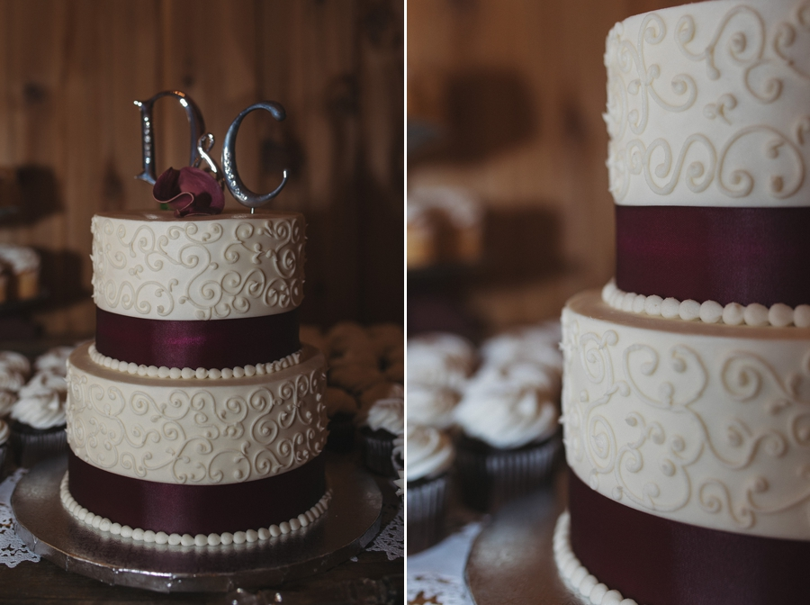 wedding cake with swirls and burgundy ribbon