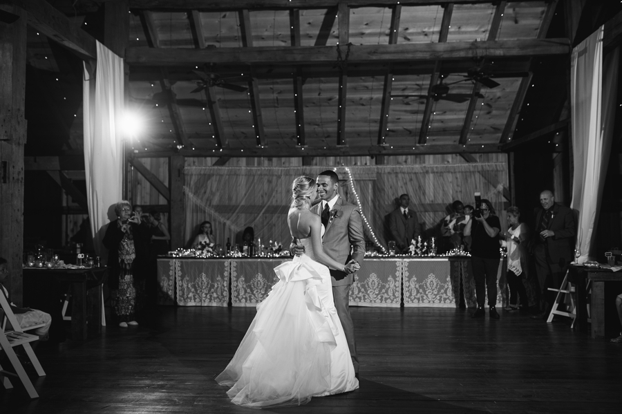 wide black and white photo of first dance at vinberige vineyard
