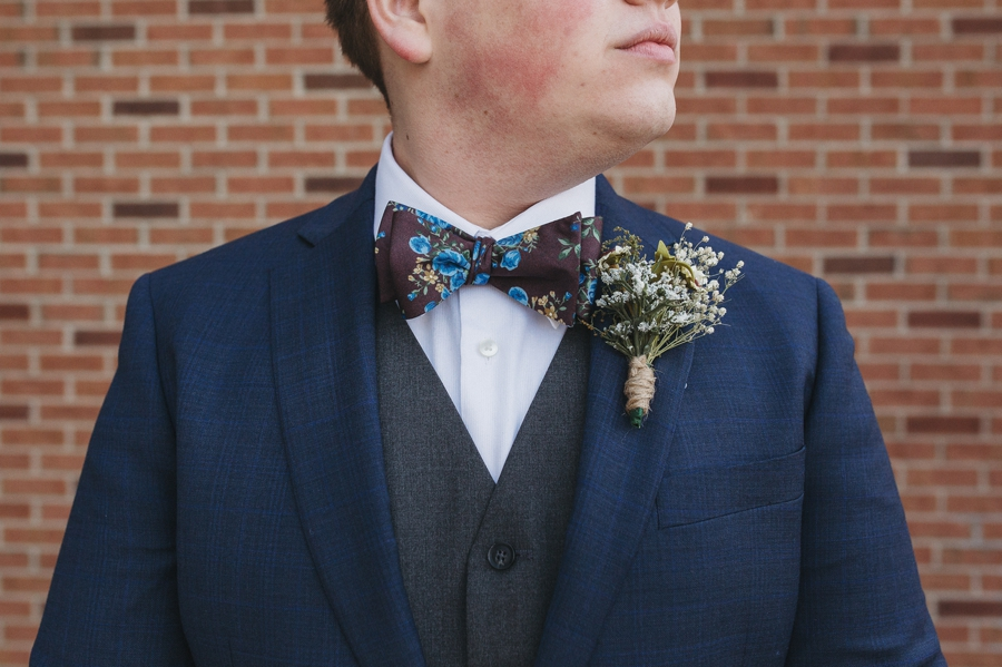 close up of grooms floral bow tie