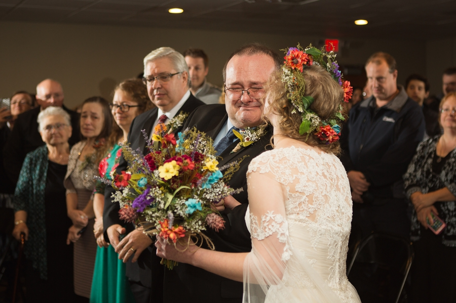 bride kissing father on cheek