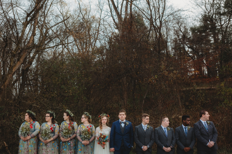 bride and groom holding hands with wedding party in newark ohio
