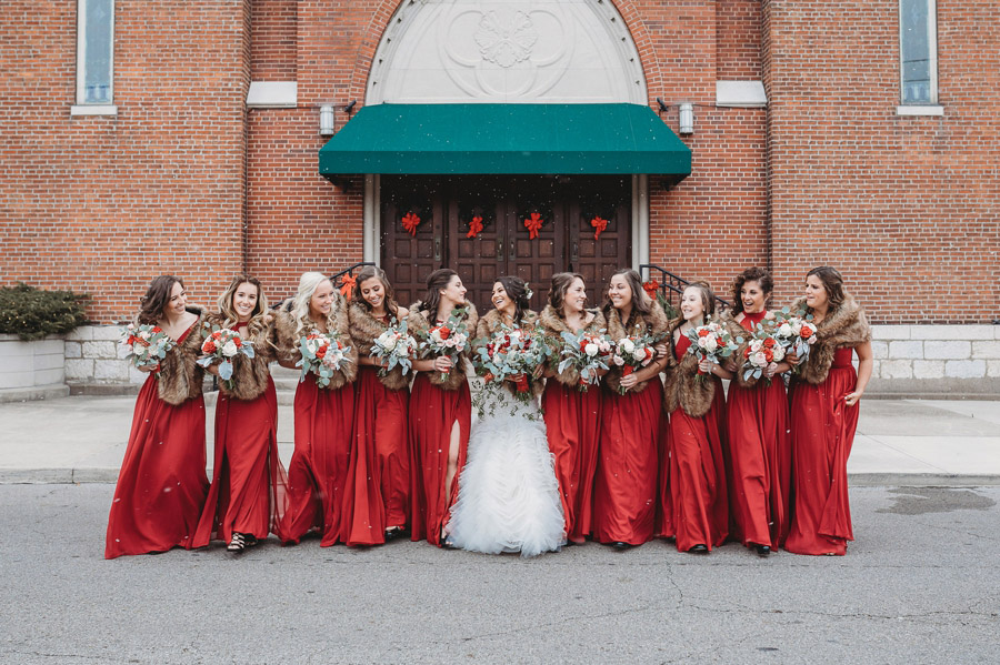 bride walking with bridesmaids at The Vault Columbus Ohio winter wedding