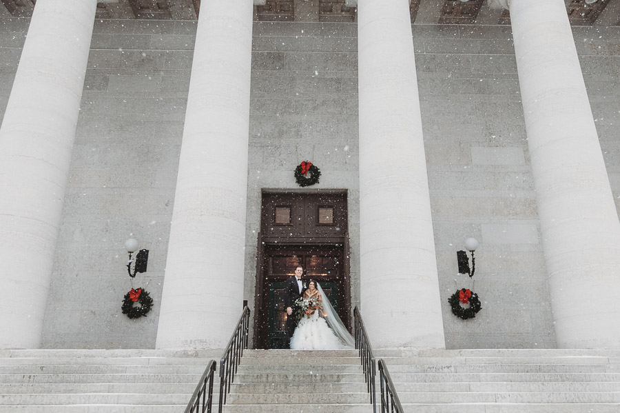 bride and groom in snow at The Vault
