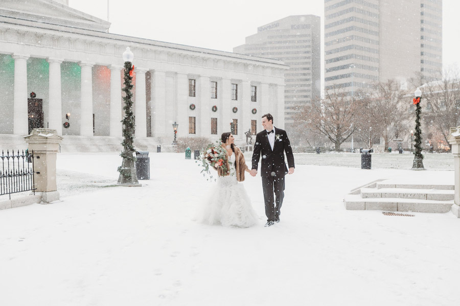 bride and groom in snow at Ohio Statehouse