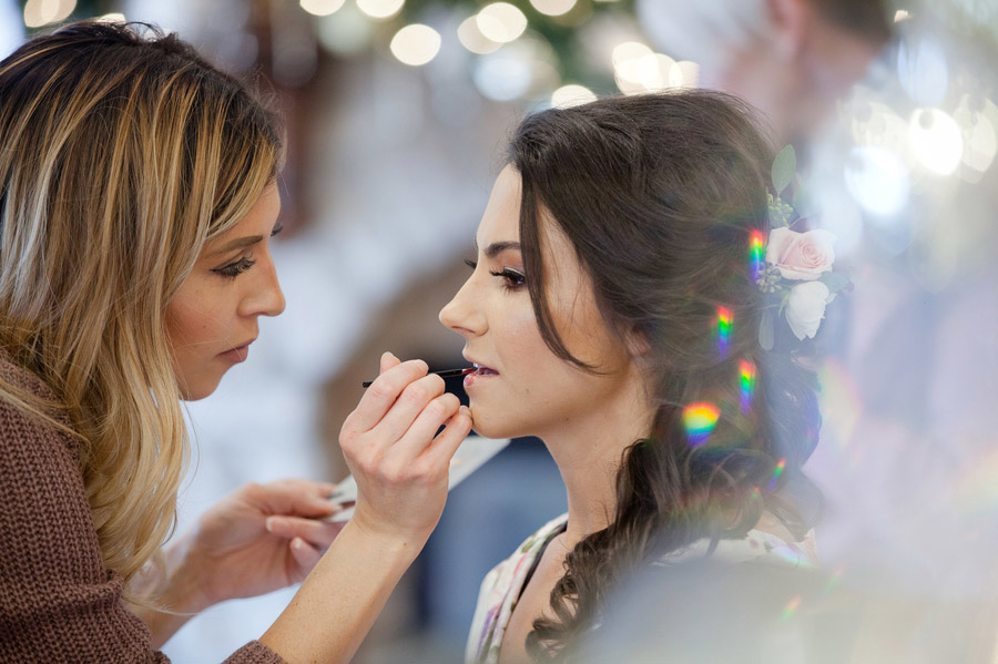 bride getting makeup on