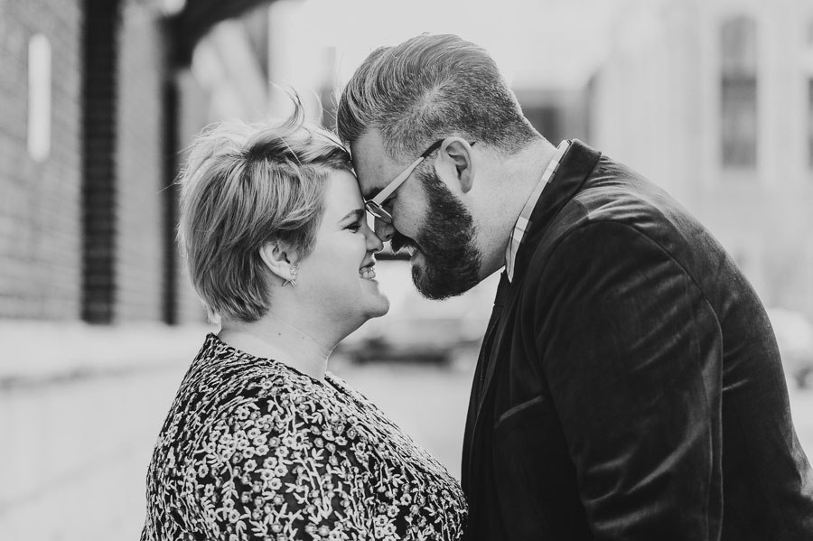 engaged couple with foreheads together at downtown columbus winter engagement