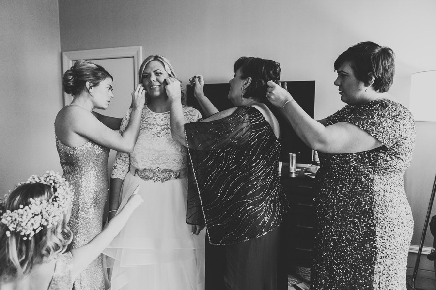bride and bridesmaids getting ready