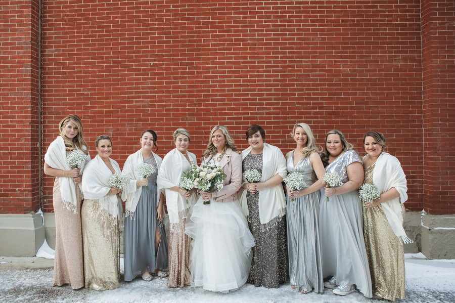 bridemaids in snow outside of the westin great southern