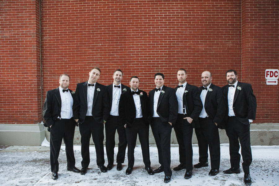 groom with groomsmen in snow at new years wedding at the westin