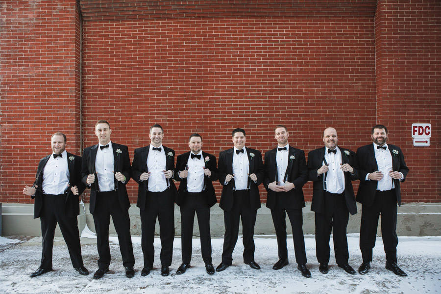 groomsmen showing off suspenders at the westin