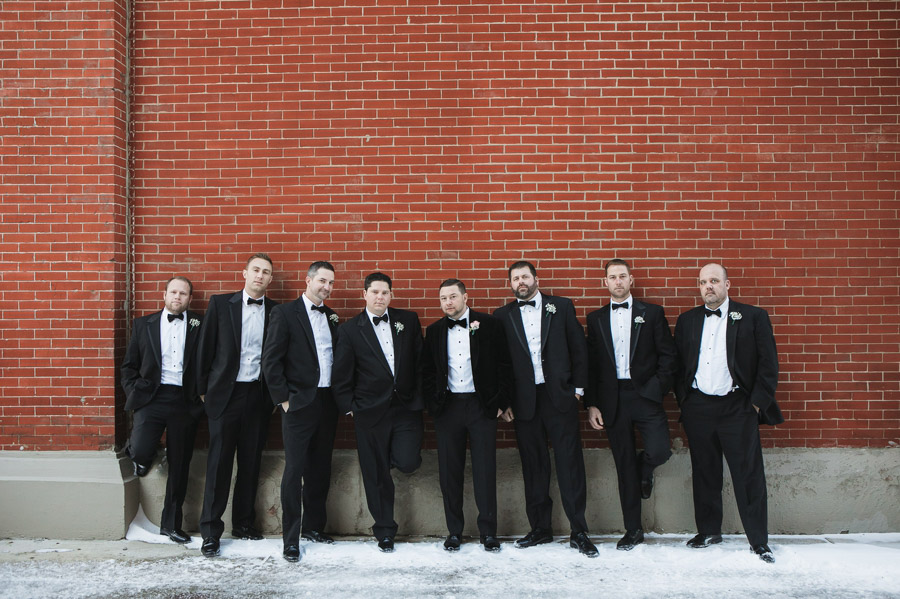 groomsmen leaning on brick wall at the westin great southern