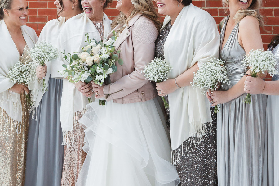 bridesmaids bouquets with metallic dresses