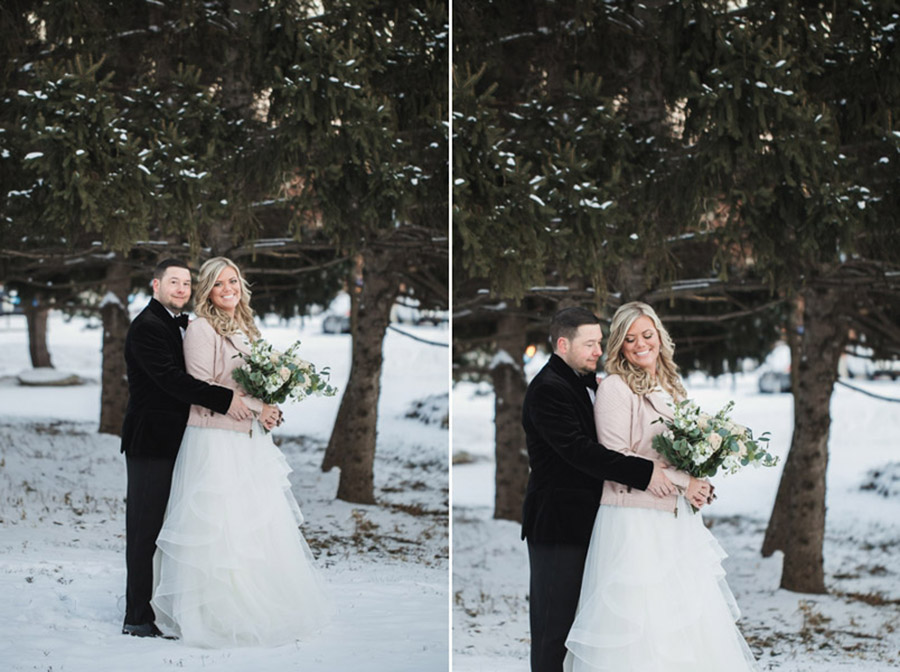 groom hugging bride in snow at new years wedding