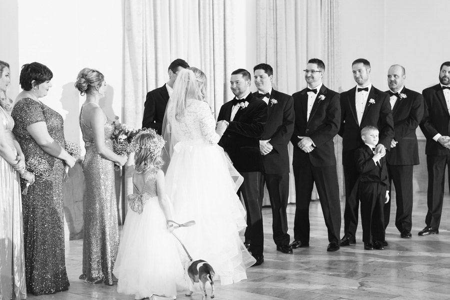 black and white photo of groom looking at bride during ceremony