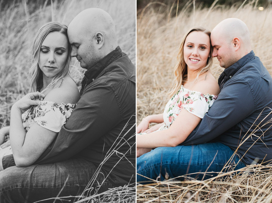 engaged couple sitting in grassy field at gorman nature center