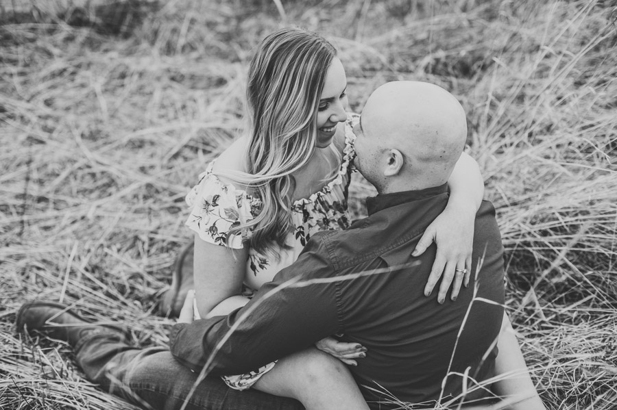 Gorman Nature Center engagement black and white photo of couple in grassy field