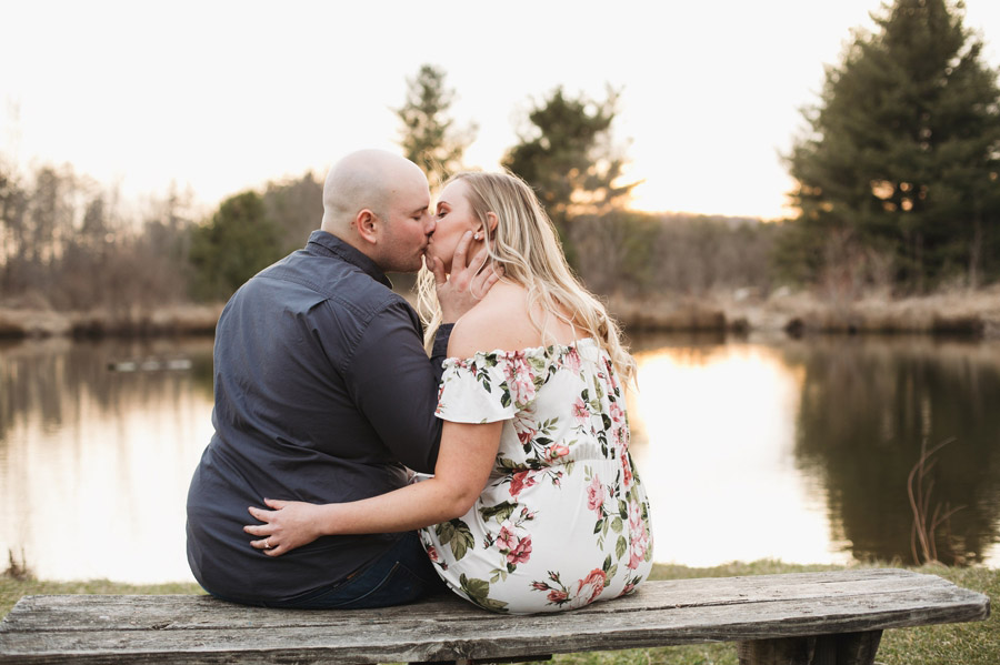 Gorman Nature Center engagement of couple kissing on a bench