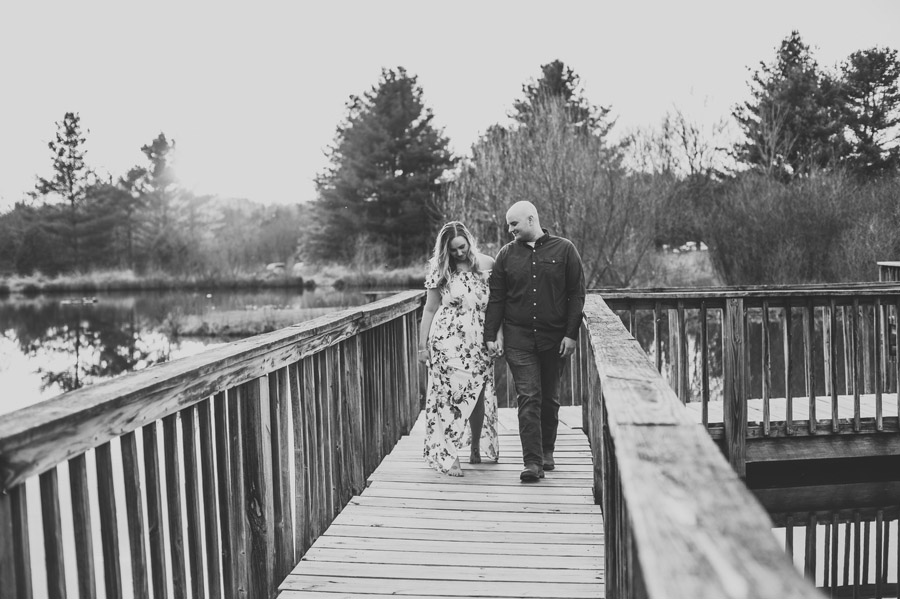 black and white photo of couple walking at Gorman Nature Center Engagement Photos