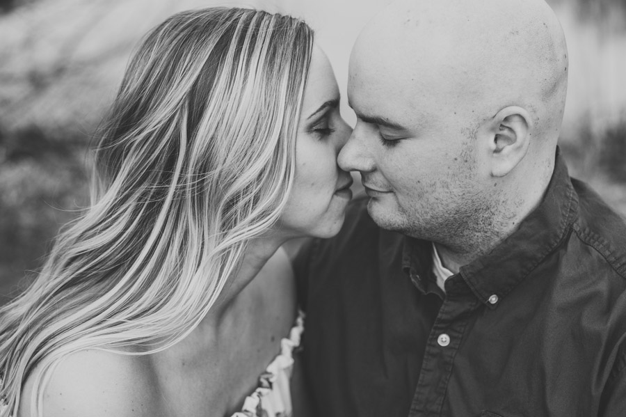 black and white photo of engaged couple at gorman nature center