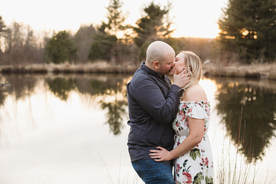 engaged couple kissing by pond in mansfield ohio
