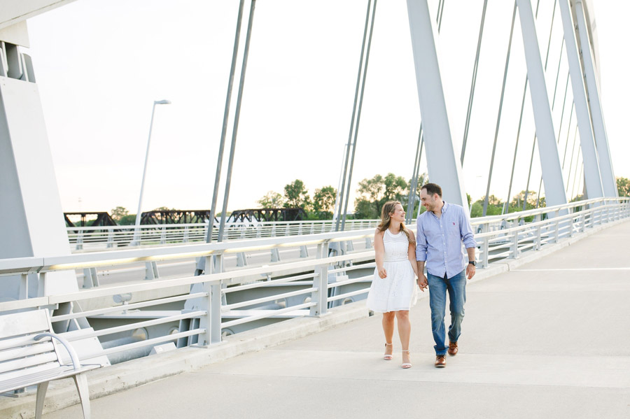 engagement of couple walking at scioto mile