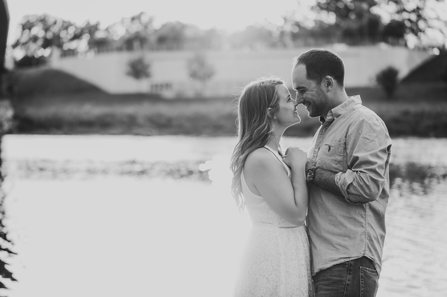 black and white photo of engaged couple with noses together
