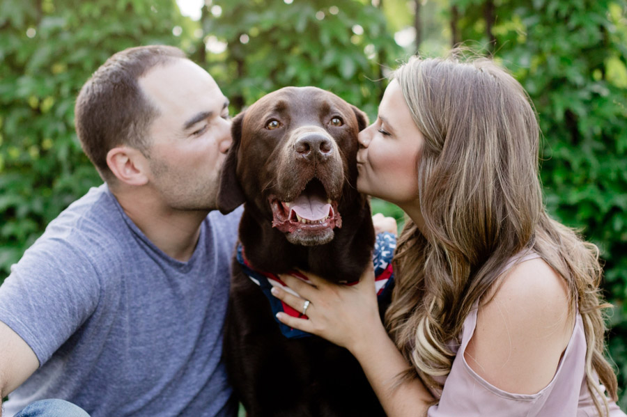 engaged couple kissing dog at scioto mile