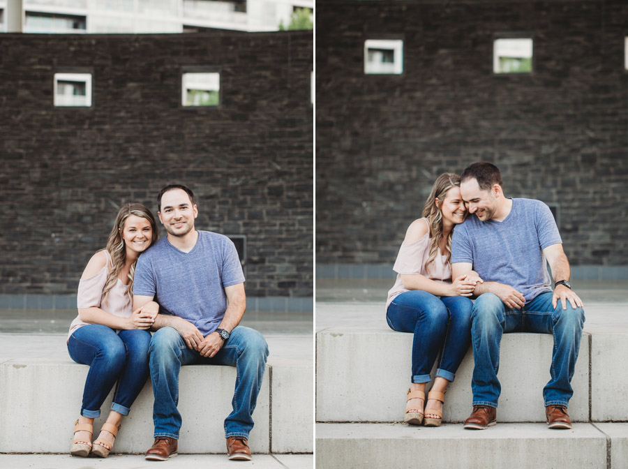 engaged couple sitting on steps at bicentennial park scioto mile