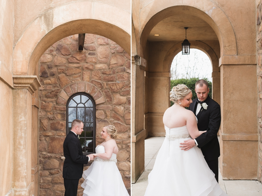 bride and groom holding hands under arch