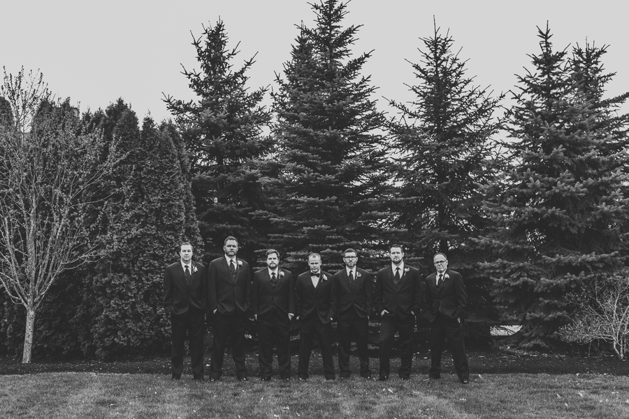 black and white photo of groom with groomsmen not smiling