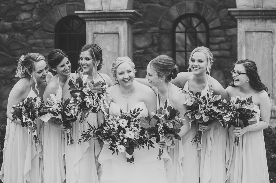 black and white photo of bride and bridemaids laughing