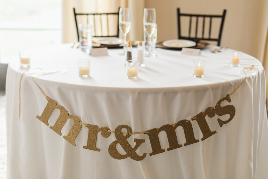 glitter mr and mrs banner on table