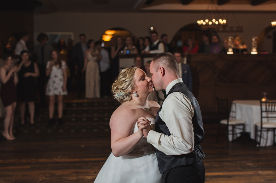 bride and groom kissing during first dance at club at corazon