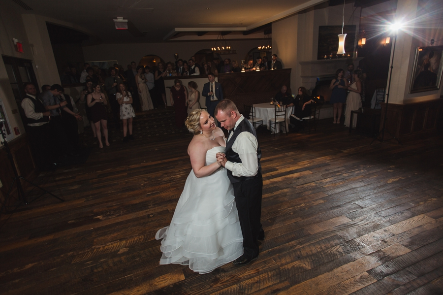 wide photo of bride and groom first dance