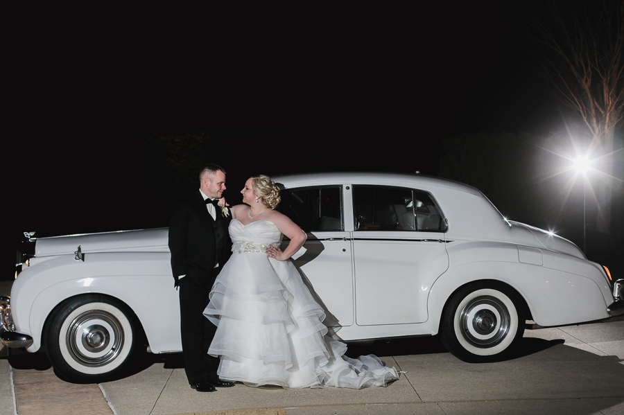 bride and groom in front of a Bentley car at club at corazon
