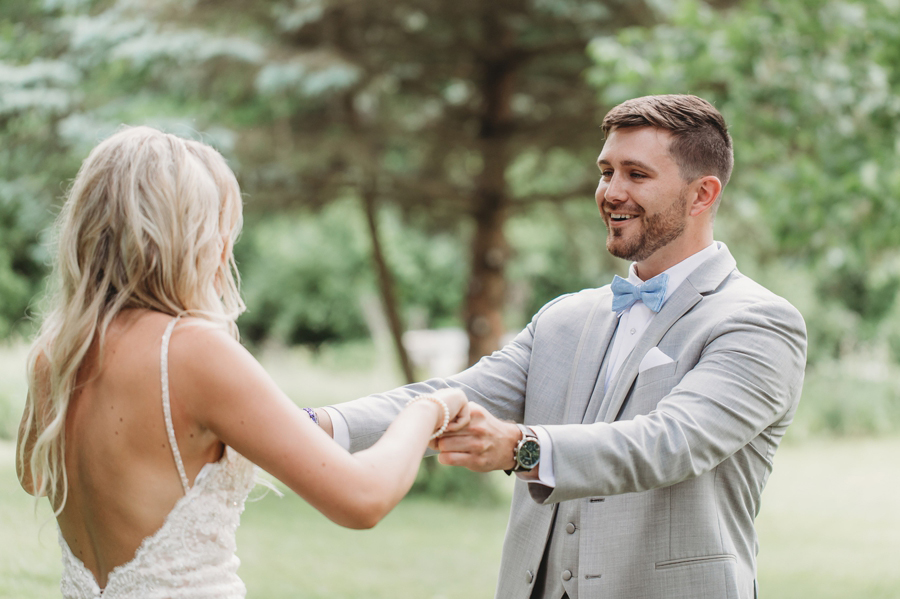 photo of groom at first look